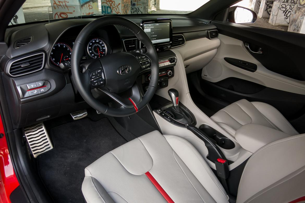 08-<a href=https://www.autopartmax.com/used-hyundai-engines>hyundai</a>-veloster-2019-cockpit-shot--front-row--interior.jpg