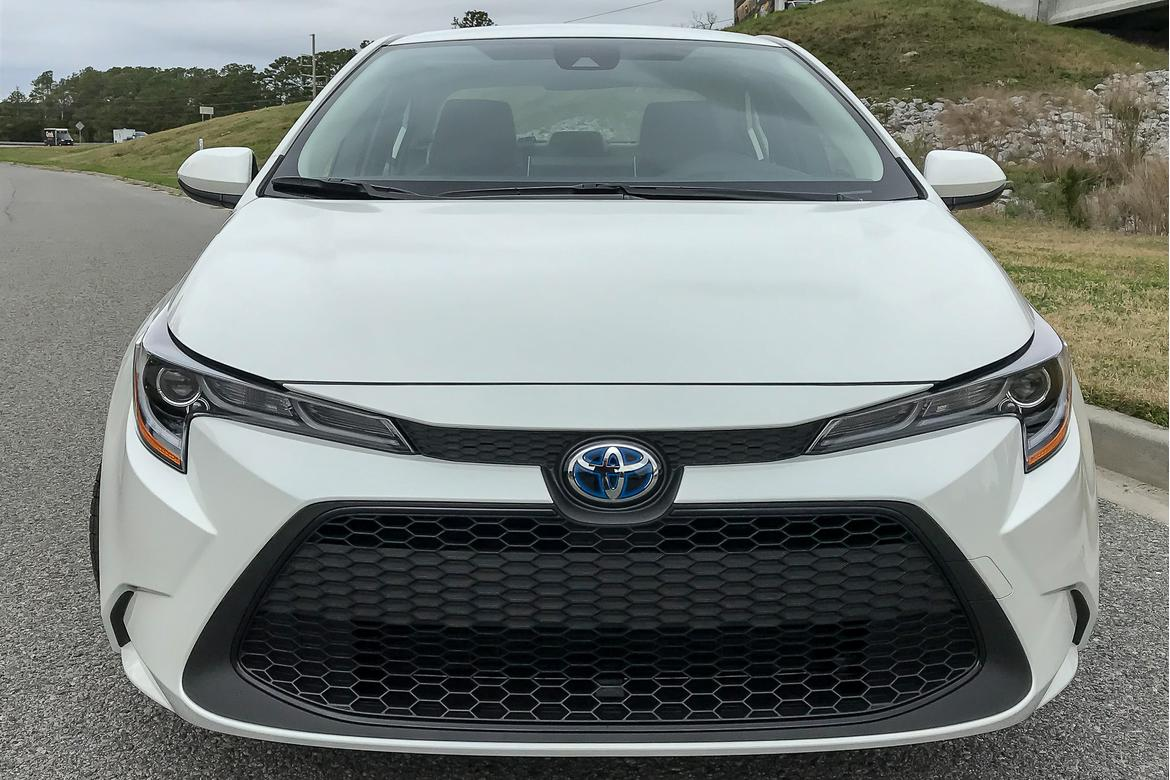 14-<a href=https://www.sharperedgeengines.com/used-toyota-engines>toyota</a>-corolla-2020-exterior--front--white.jpg