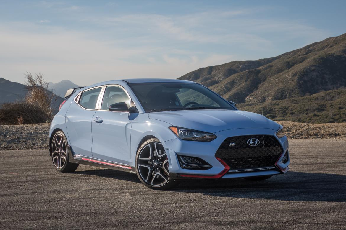 01-<a href=https://www.autopartmax.com/used-hyundai-engines>hyundai</a>-veloster-n-2019-angle--blue--exterior--front--orange.