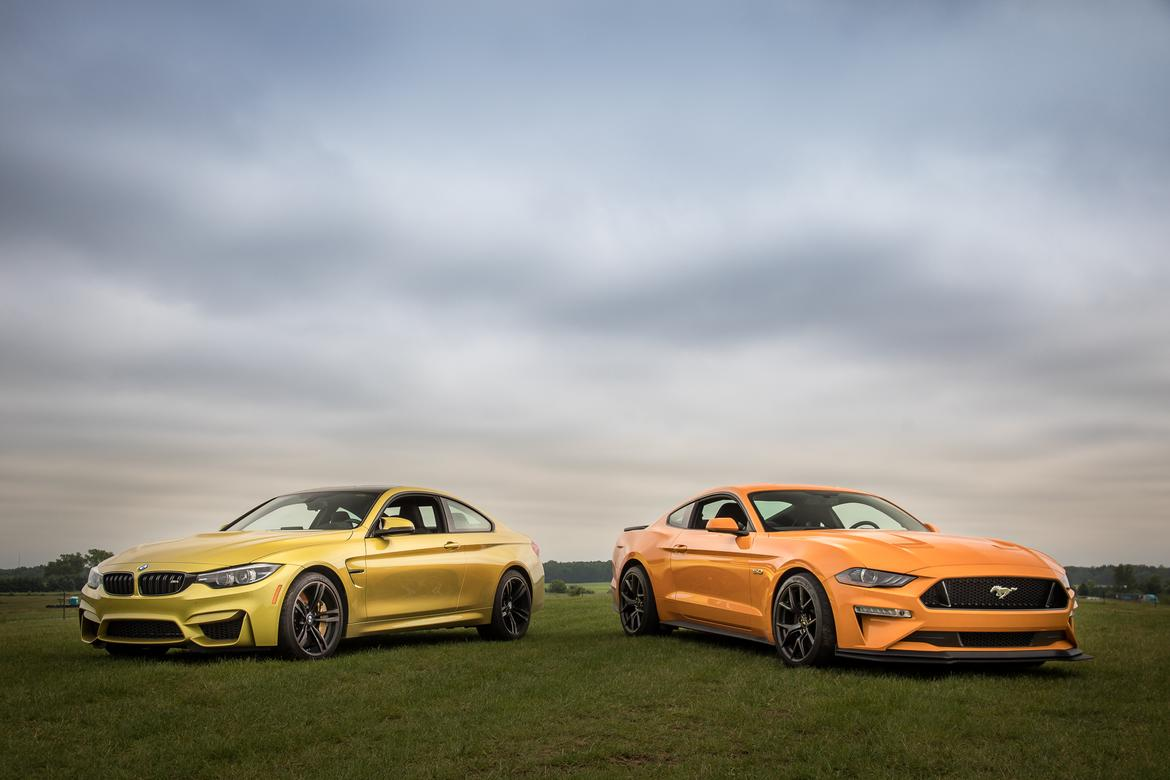 01-bmw-m4-2018-vs-ford-mustang-gt-pp2-2018-angle--exterior--fron