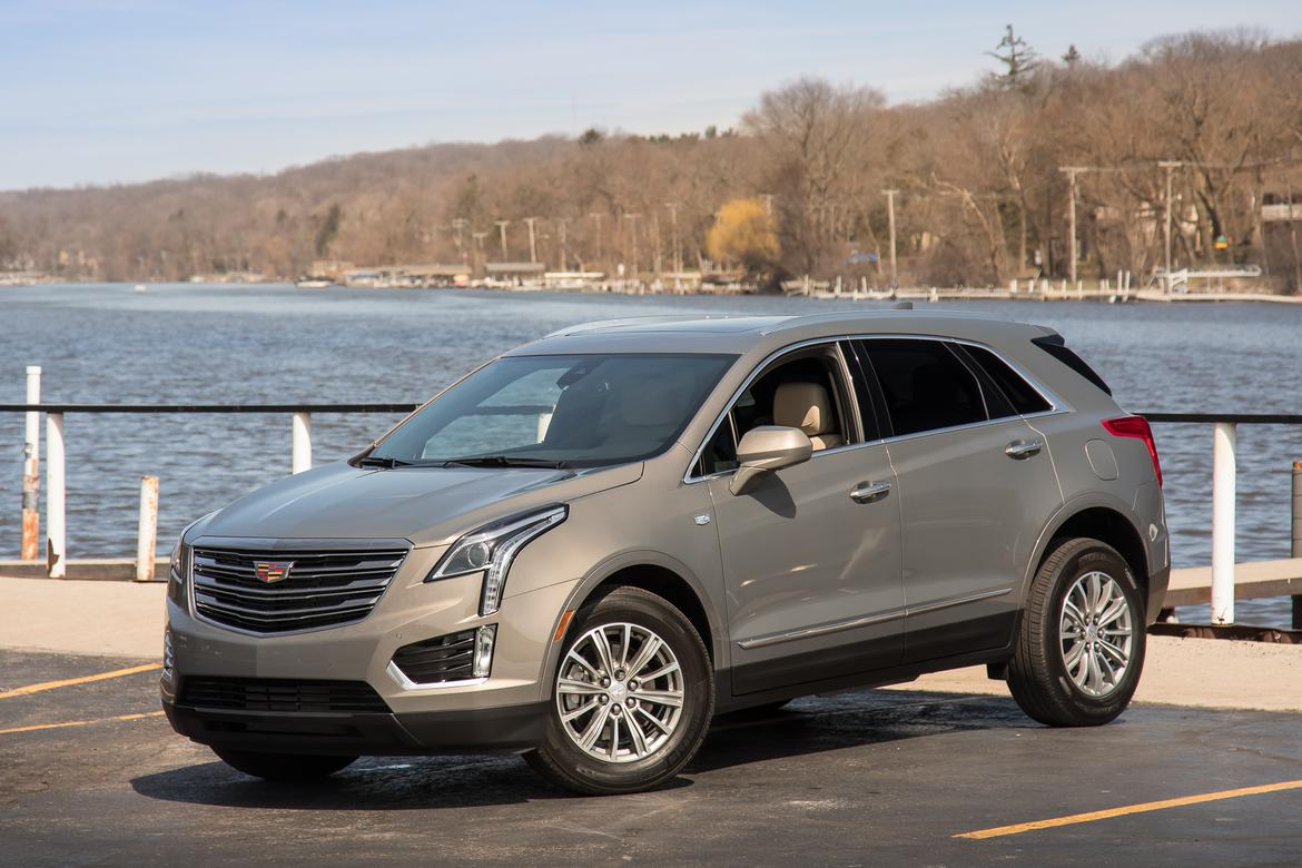 04-<a href=https://www.sharperedgeengines.com/used-cadillac-engines>cadillac</a>-xt5-2018-lc-suv-chl-cl-angle--exterior--front--gold.