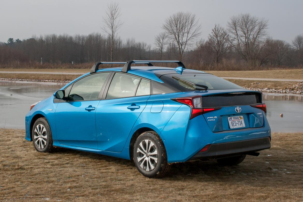 16-<a href=https://www.autopartmax.com/used-toyota-engines>toyota</a>-prius-2019-angle--blue--exterior--off-road--rear--snow
