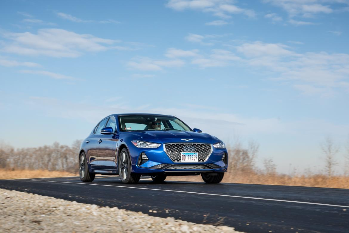 01-genesis-g70-2019-angle--blue--exterior--front.jpg