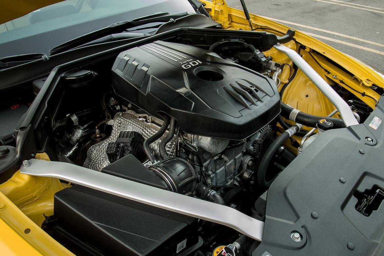 kia-stinger-2018-09-engine, manufacturer event, yellow.jpg