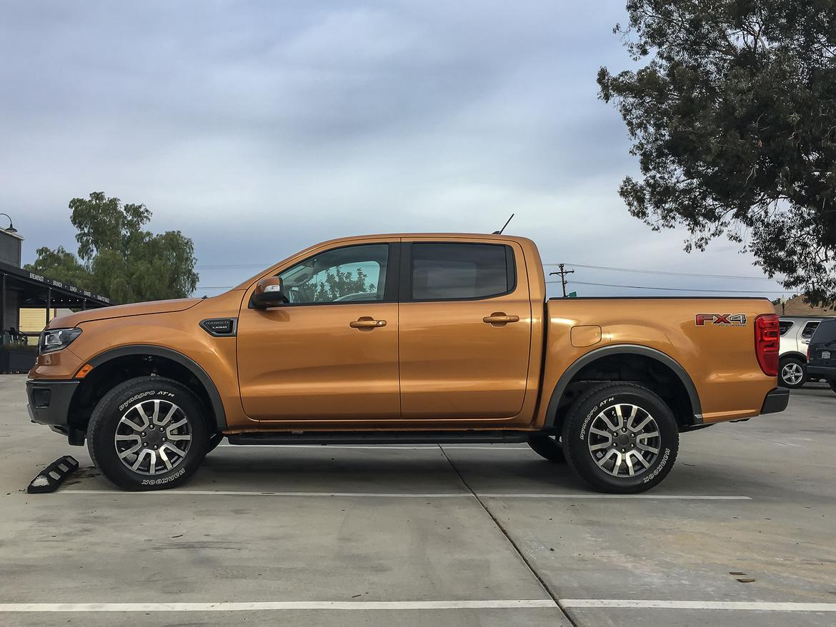 03-<a href=https://www.sharperedgeengines.com/used-ford-engines>ford</a>-ranger-2019-exterior--orange--profile.jpg