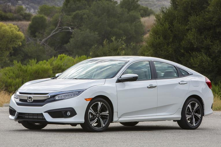 which to buy 2017 honda civic sedan or hatchback